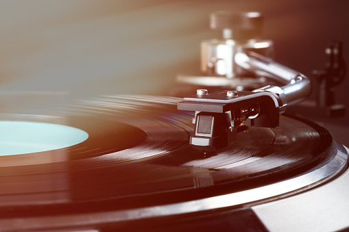 vintage turntable in action close up