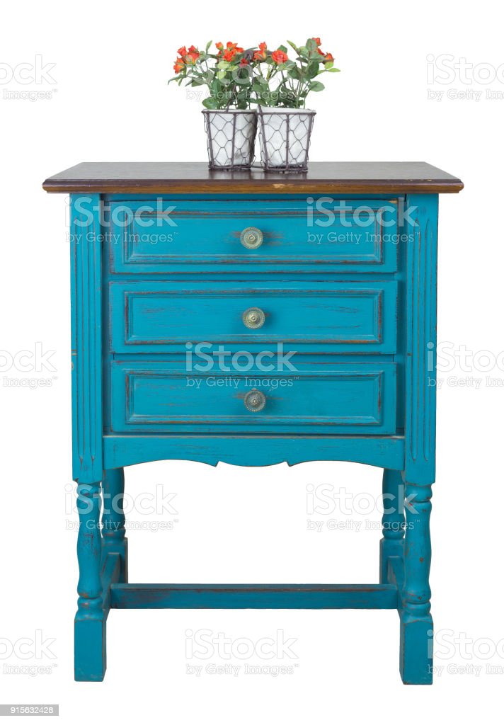 Vintage turquoise commode (Chest of Drawers) with 3 drawers with brass fittings and flower planter isolated on white background including clipping path stock photo