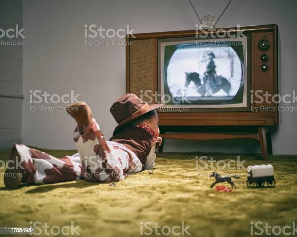 Vintage tv and little boy cowboy picture id1127854954?b=1&k=6&m=1127854954&s=612x612&h=0vqyzl1rxznsmdgdzhr5nykbgn5b wt63ibvkqh8wfg=