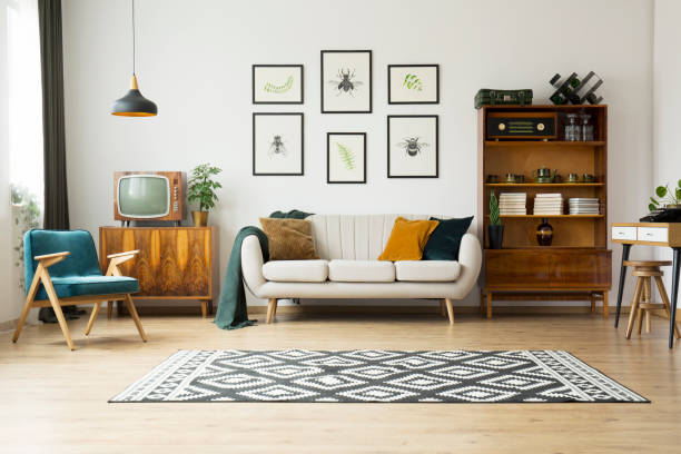 Vintage tv next to couch stock photo