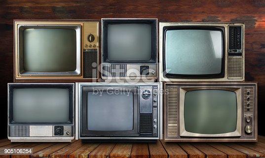 istock Vintage tv on wood shelf background 905106254