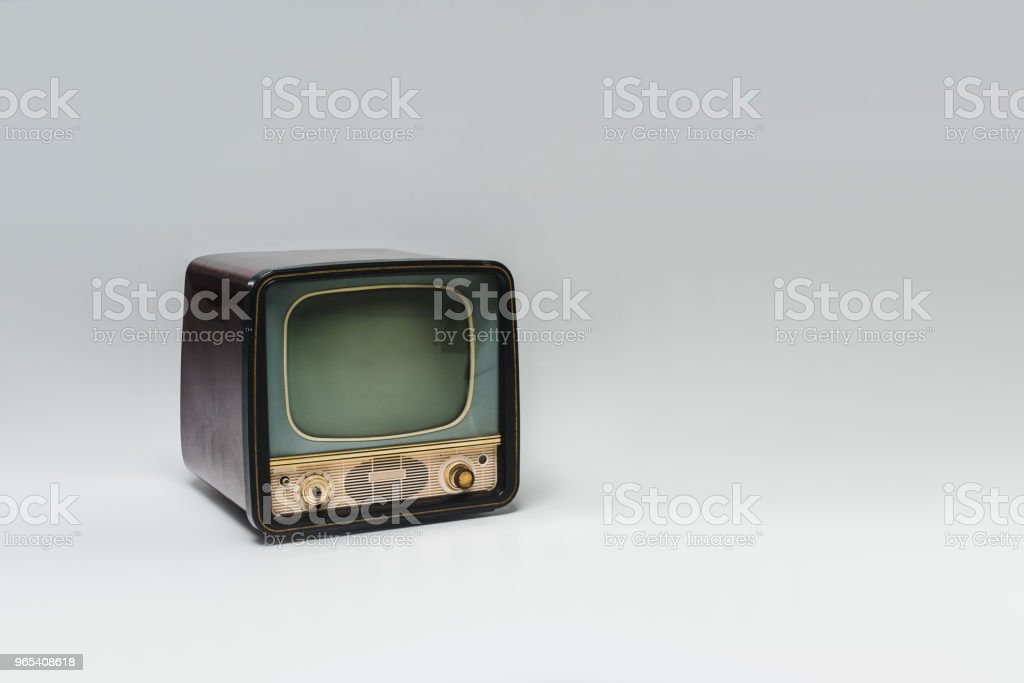 vintage tv with blank screen on grey surface royalty-free stock photo