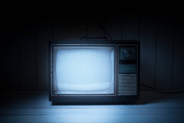 Vintage TV with static on white wooden background