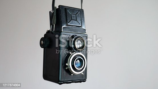 Vintage two lens photo camera isolated on white background.