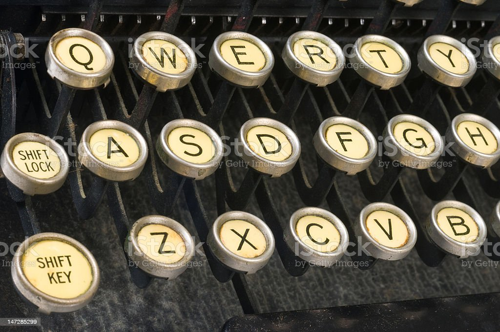Vintage typewriter closeup QWERTY keys horizontal stock photo