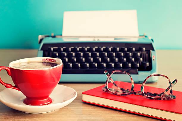 Vintage typewriter, coffee cup and eyeglasses stock photo