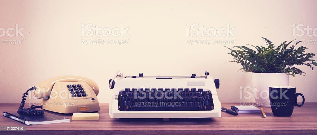 Vintage typewriter in office setting stock photo