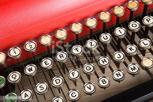 istock vintage typewriter keyboard close up concept for writing, journalism, blogging 1162926576