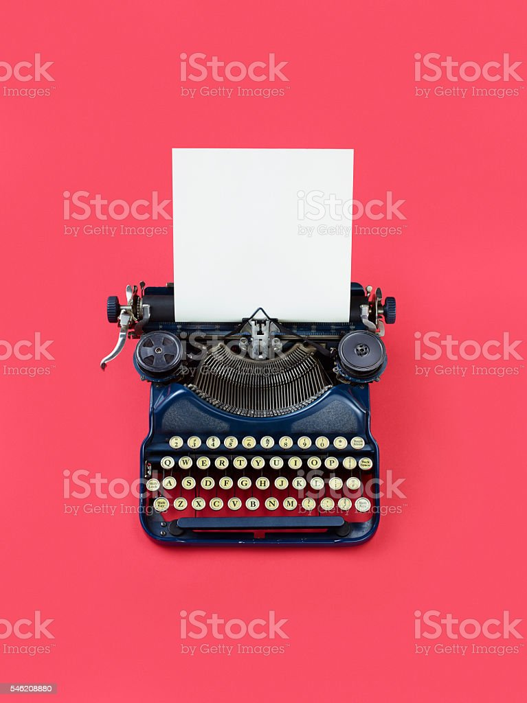 Vintage Typewriter On Red Background stock photo