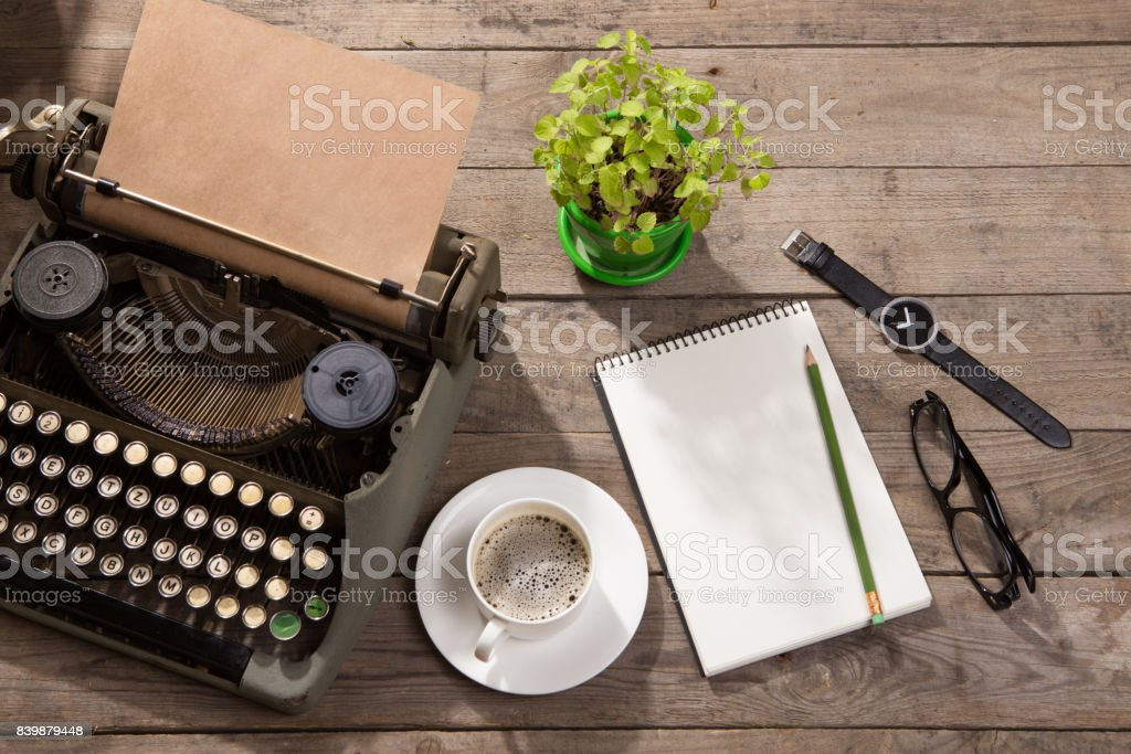 Vintage typewriter on the old wooden desk stock photo