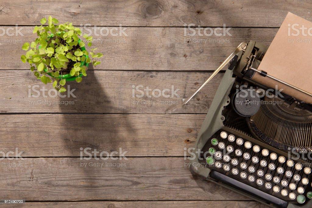 Vintage typewriter on the old wooden desk stock photo