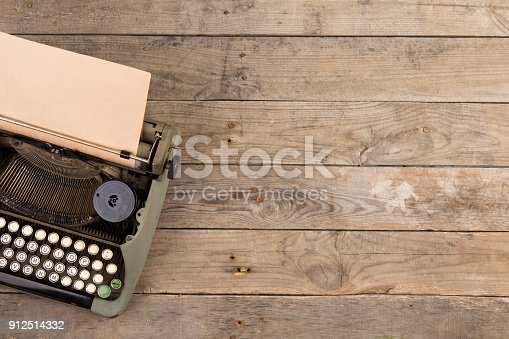 istock Vintage typewriter on the old wooden desk 912514332