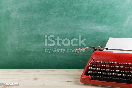 istock vintage typewriter on the table with blank paper - concept for writing, journalism, blogging 1149567876