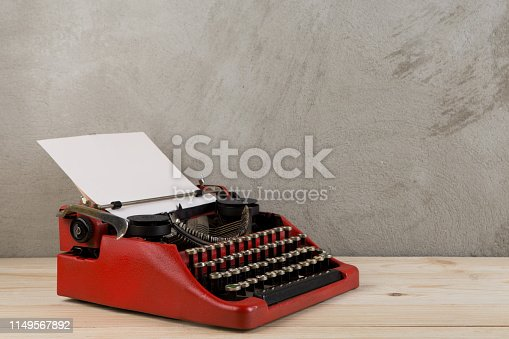 istock vintage typewriter on the table with blank paper - concept for writing, journalism, blogging 1149567892