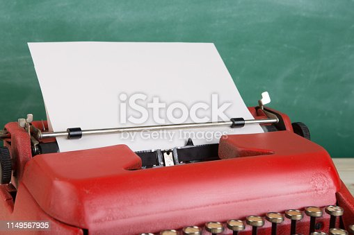 istock vintage typewriter on the table with blank paper - concept for writing, journalism, blogging 1149567935
