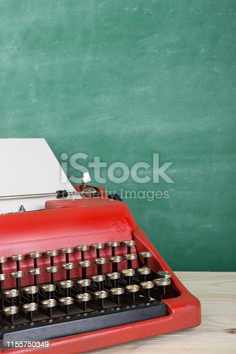 istock vintage typewriter on the table with blank paper - concept for writing, journalism, blogging 1155750349