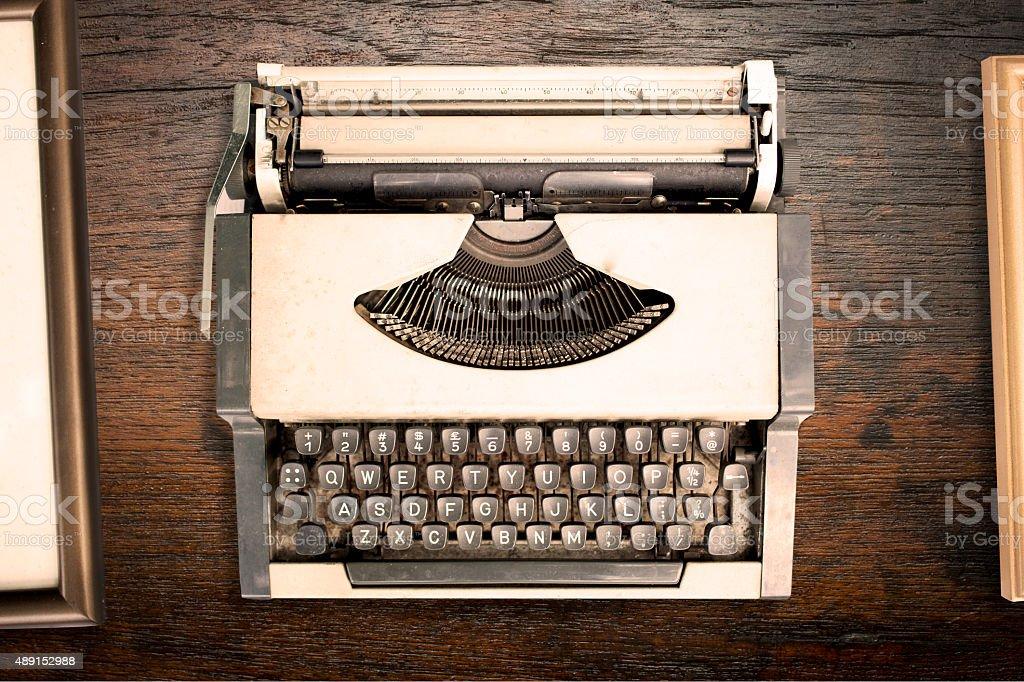 Vintage typewriter on wooden table stock photo