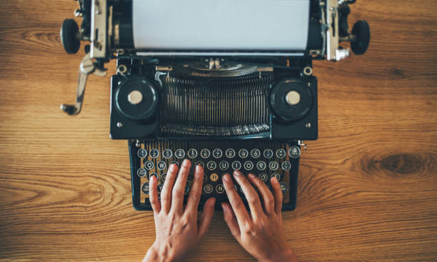Vintage typewriter on writer's desk stock photo