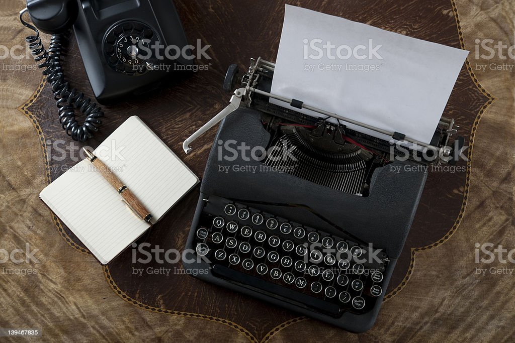 Vintage typewriter, pen and paper on an antique table stock photo