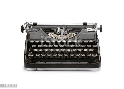 Vintage rusty typewriter isolated on white background