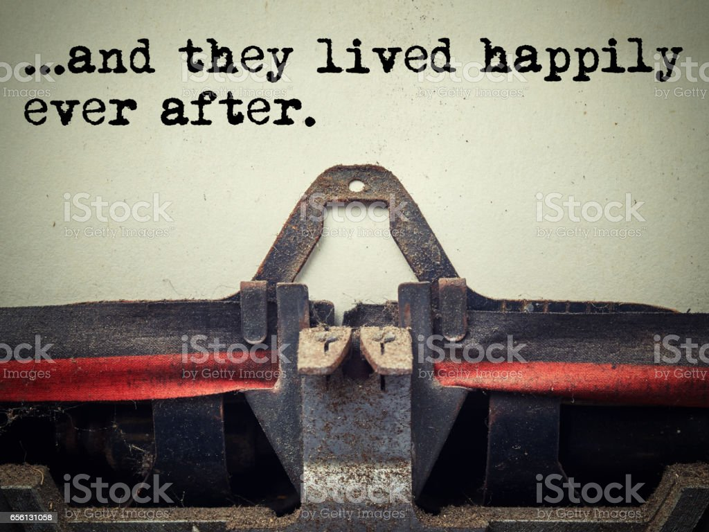 Vintage typewriter they lived happily ever after text stock photo