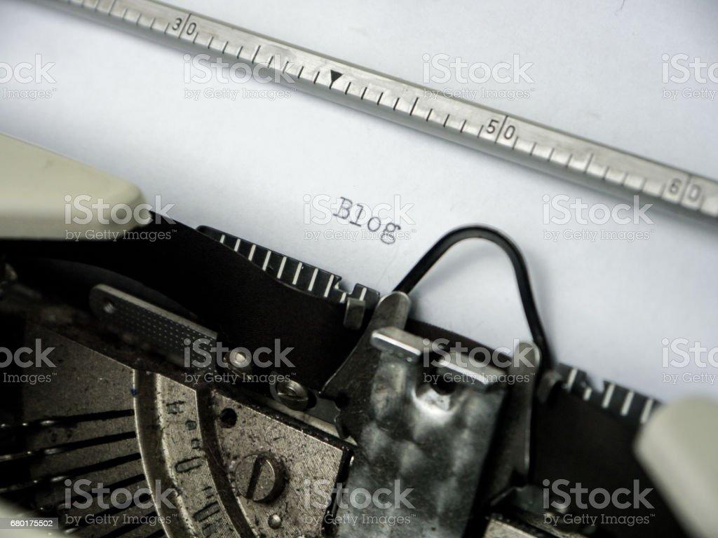 Vintage Typewriter typing 'Blog' on white paper stock photo