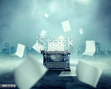 istock Vintage typewriter, urban landscape on background 658137916