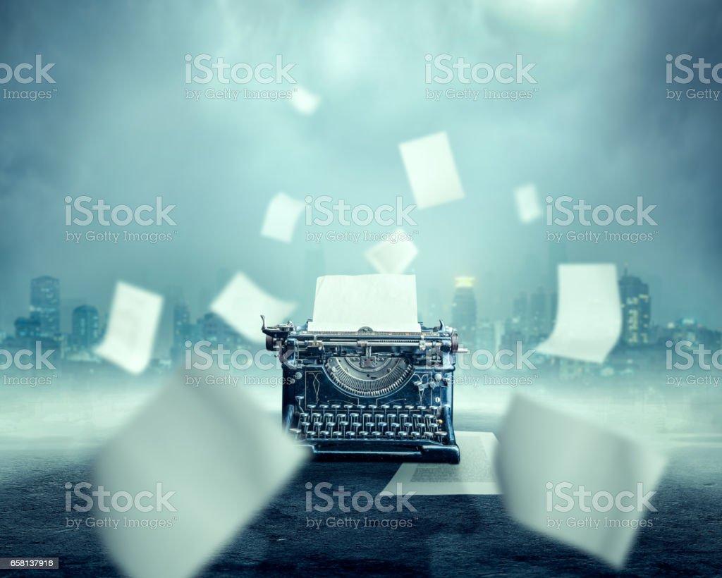 Vintage typewriter, urban landscape on background stock photo