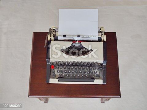 istock Vintage typewriter waiting on my desk for work 1024806052