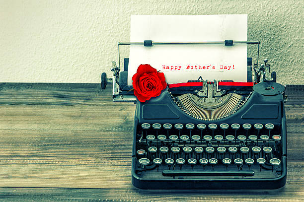 vintage typewriter with white page and red rose flower - happy mothers day type stock photos and pictures