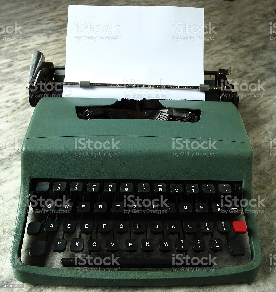 Vintage typewriter with white paper copy space royalty-free stock photo