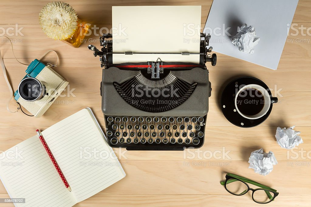 Vintage typewriter with work stuff overhead - Stock image .
