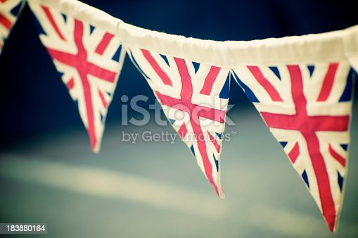 Union Jack Flag bunting hangs in the street ready for the party