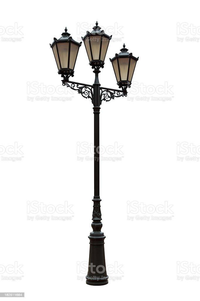 Vintage unlit iron street lamp stock photo
