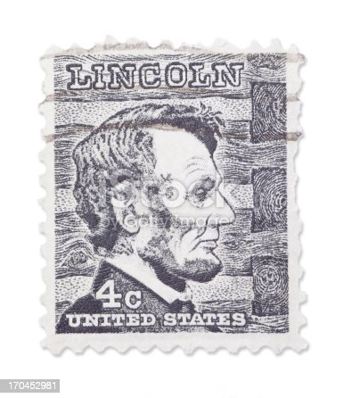 Vintage US stamp with Abraham Lincoln portrait portrait. Isolated on white with light shadow. Canon 5D Mark II.