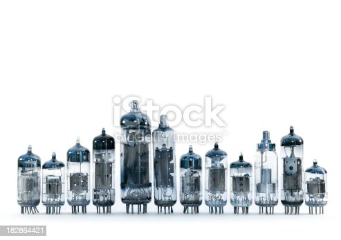 Chorus line of different vacuum tubes from the 80's isolated on white background.