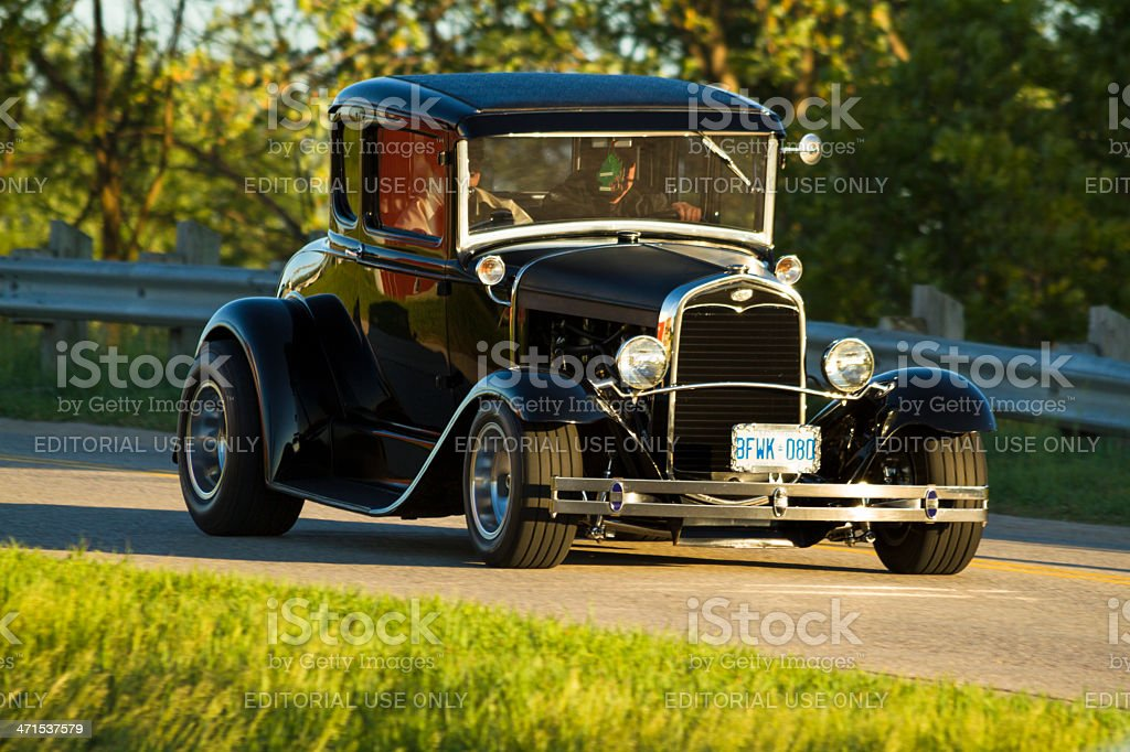Vintage Vehicle Driving In A Classic Car Cruise Parade stock photo