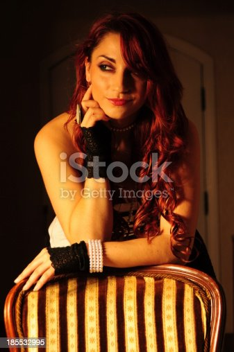861629426 istock photo Vintage victorian glamour lady with curly red hair wearing gloves 185532995