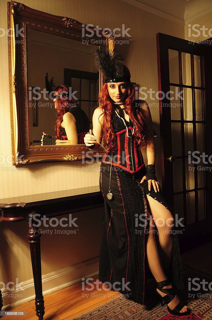 Vintage victorian glamour red hair lady with gloves and feather royalty-free stock photo