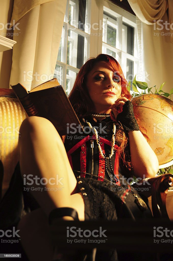Vintage victorian glamour red hair lady with gloves holding book royalty-free stock photo