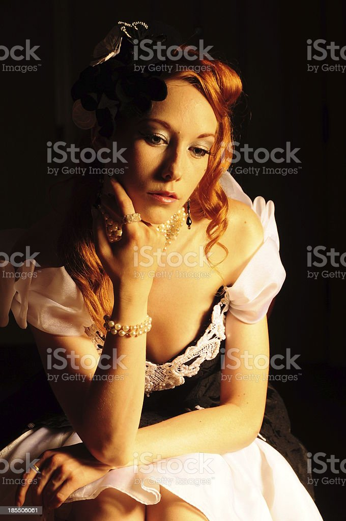 vintage victorian glamour redhead lady sitting in dress with hat royalty-free stock photo