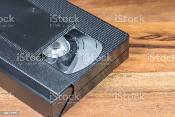 Vintage Video Cassette on Wooden Background