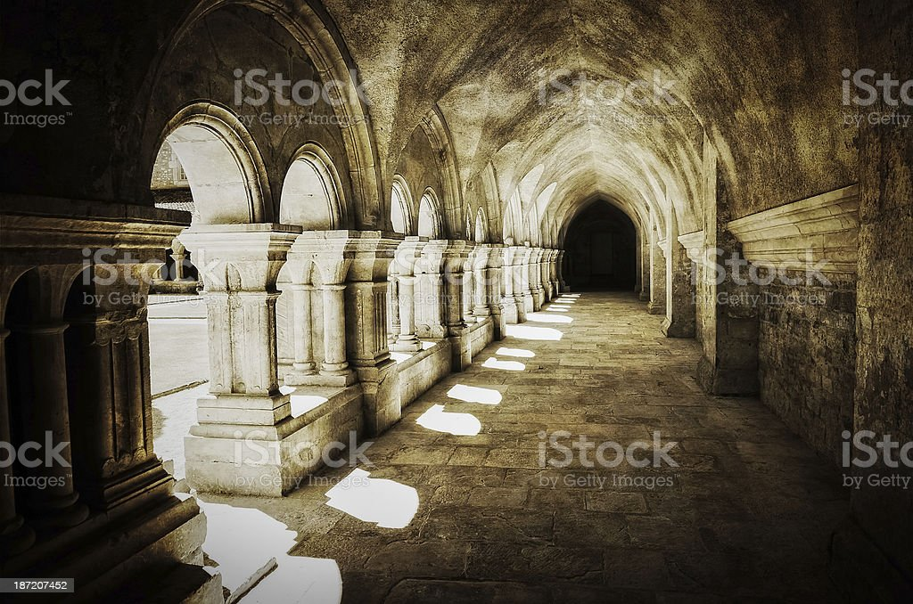 Vintage view of old archway in Abbaye de Fontenay stock photo