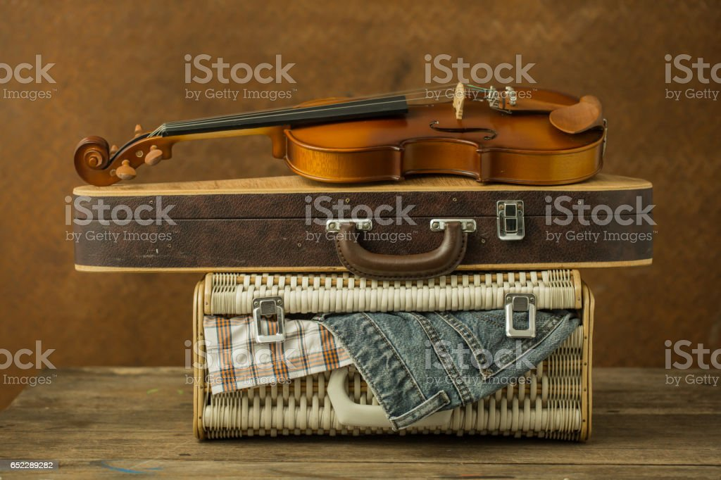 Vintage violin and case with old steel background stock photo