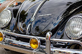 Miami, Florida USA - February 28, 2016: Close up view of the front of a beautifully restored vintage German Volkswagen Beetle at a public car show.