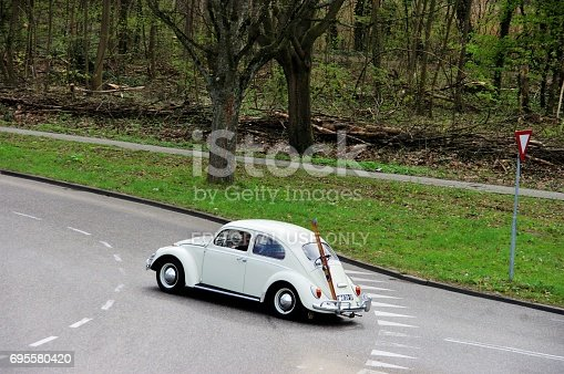 Brunssum, the Netherlands - March 30, 2014. Vintage VW Beetle on the street passing a roundabout in the city.