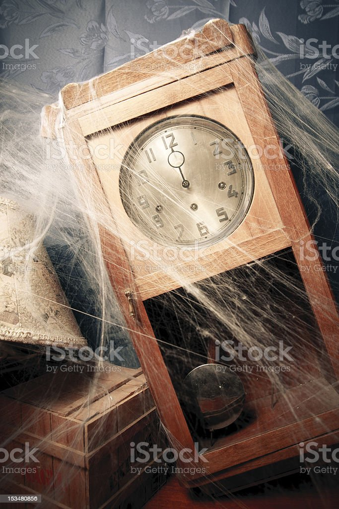 vintage wall clock full of cobwebs royalty-free stock photo