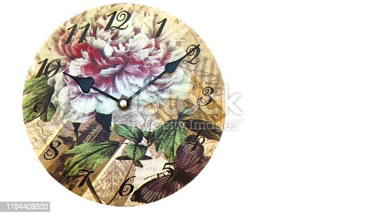 671883446 istock photo Vintage wall clock with flowers and black hands on white background with copy space 1194409320