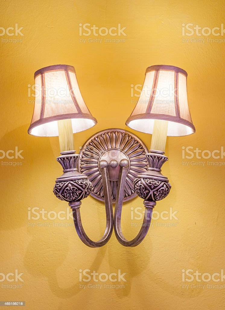 Vintage wall lamp on the yellow wall stock photo