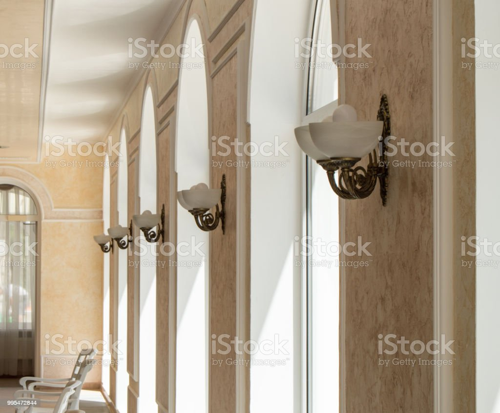 Vintage Wall Lights Hang Along The Window Openings In A Row Indoors Stock Photo Download Image Now